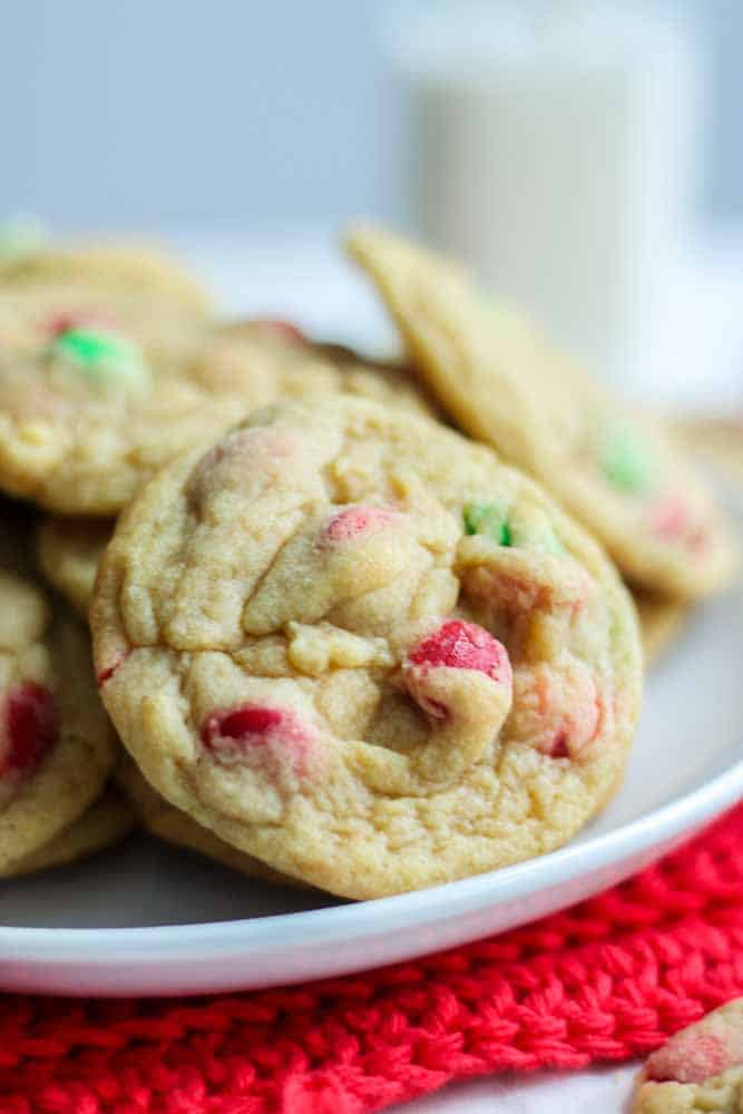 These soft and chewy M&M cookies are the best Christmas cookie you will make this year. They're made with butter and sugar, then eggs, vanilla extract and vanilla pudding are mixed in with the dry ingredients. Add any color of M&M for a festive holiday cookie. These red and green candies make these the best Christmas cookie recipe you will find. They stay soft and chewy for days! Store in the freezer for up to three months.