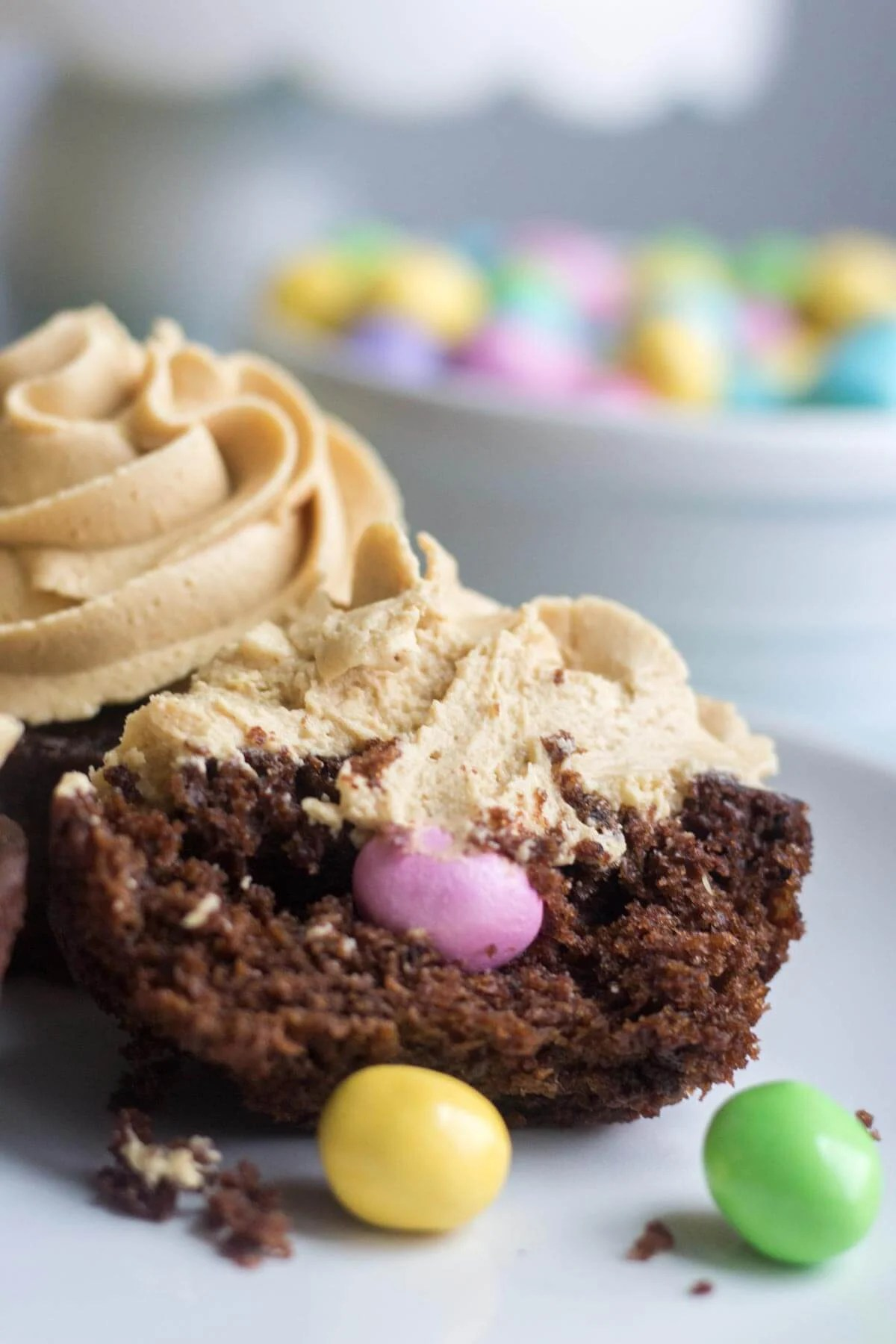 Light and fluffy chocolate cupcakes are topped with a sweet and creamy peanut butter frosting. Plus, there's a fun Easter surprise on the inside! These Chocolate Peanut Butter Piñata Cupcakes will surprise and delight all of your friends and family.