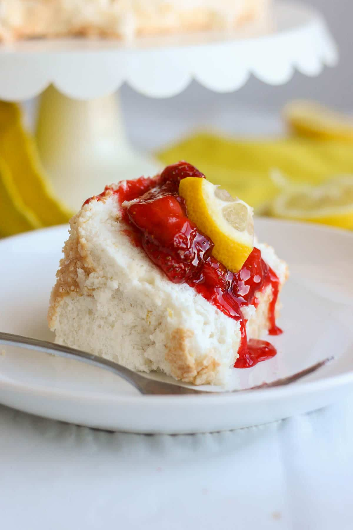 Light and fluffy, this lemon angel food cake melts in your mouth and packs a powerful citrus punch. Made with fluffy egg whites and lots of lemon zest, this cake recipe will be your new go-to for spring and summer entertaining. Serve it with strawberry compote on top for a bright bite of fruity flavor.