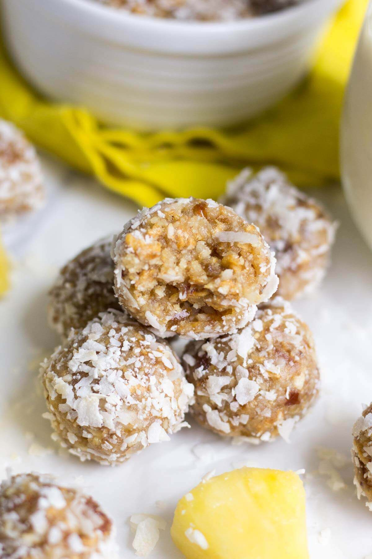 Healthy and filled with energizing ingredients, these pina colada energy bites are a sweet and healthy snack that will keep you satisfied all day. It's made with raw ingredients like cashews and macadamia nuts, plus dried fruit and coconut. This energy bite recipe will transport you to the beach!