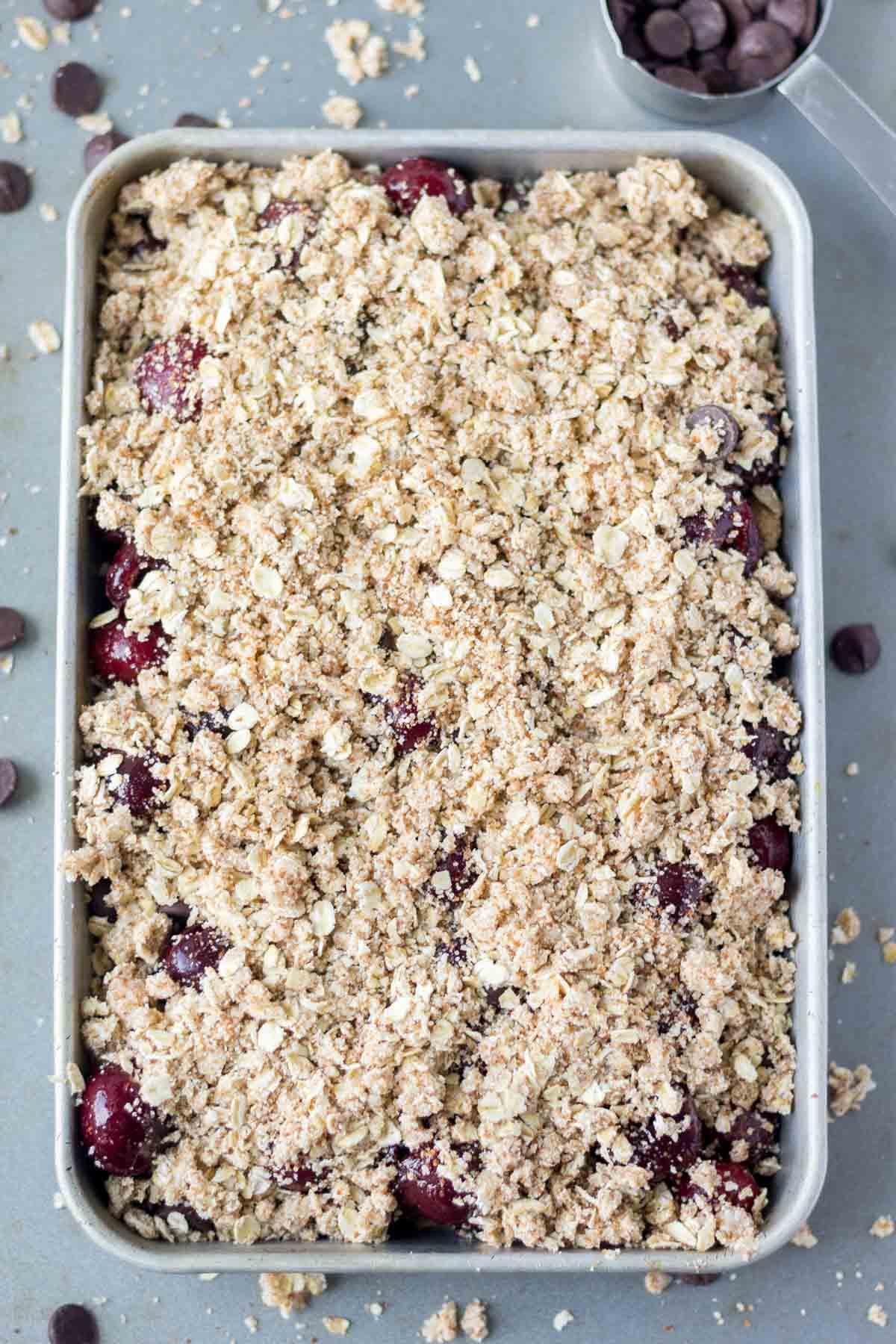 These easy cherry crisp recipe is made with frozen cherries and dark chocolate and topped with a gluten free oat crust. It's the perfect summer dessert recipe!