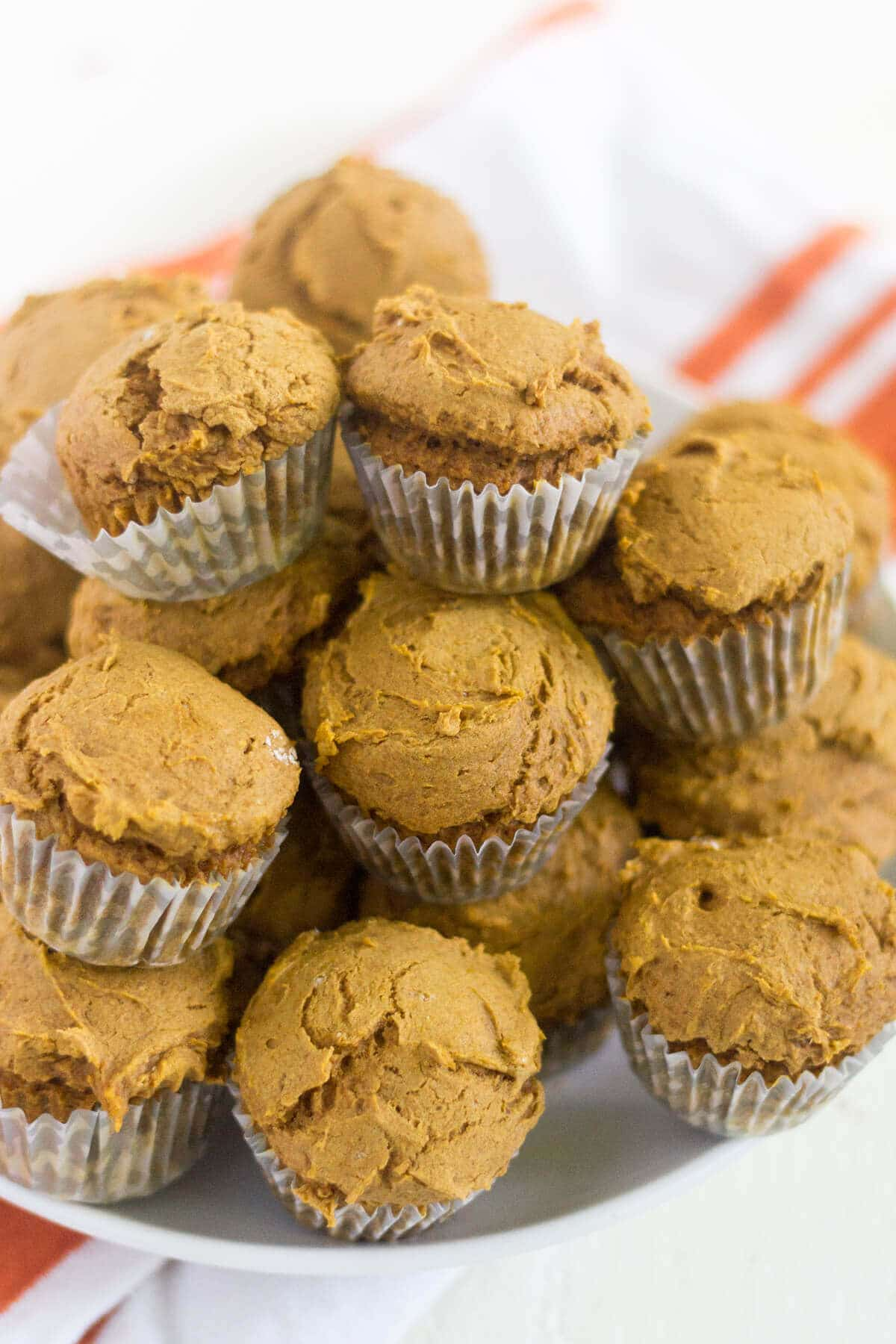 With only two ingredients, these mini pumpkin muffins are as easy as they come. Plus they're only 45 calories each! They're made without oil and eggs and they're so soft and filled with pumpkin spice flavor.