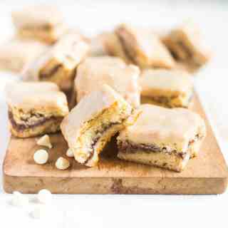 White chocolate chai spiced blondies are a mix between a cake like bar and a thick and chewy blondie. They're dense and filled with white chocolate chips, melted white chocolate and inside is a cinnamon swirl filled with chai spices!