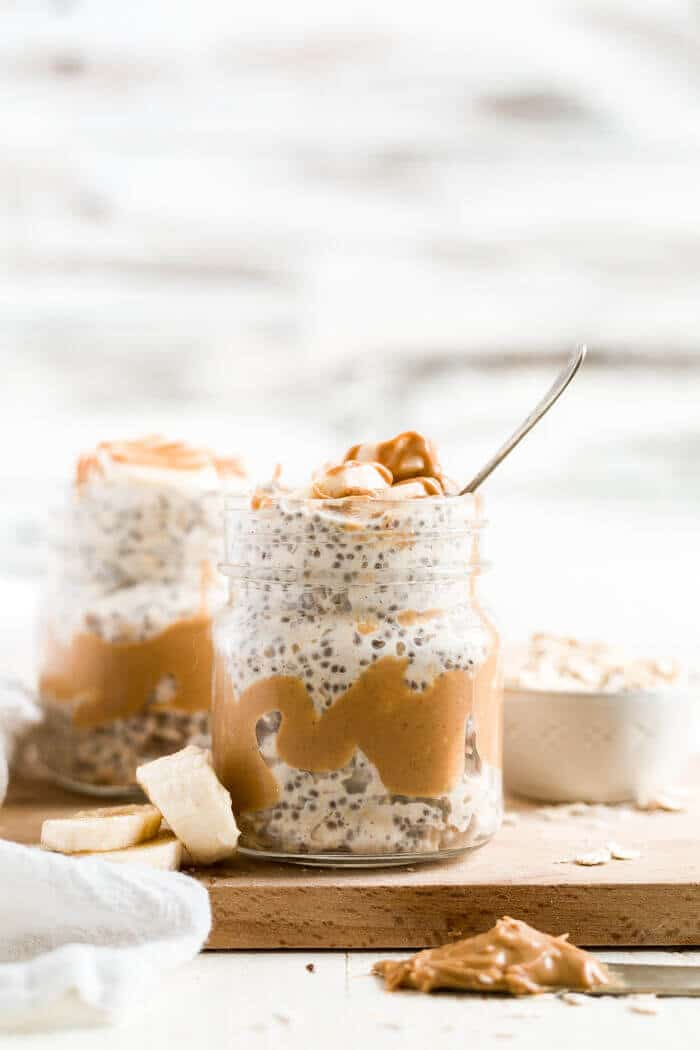 overnight oats with peanut butter and banana in a jar with a spoon