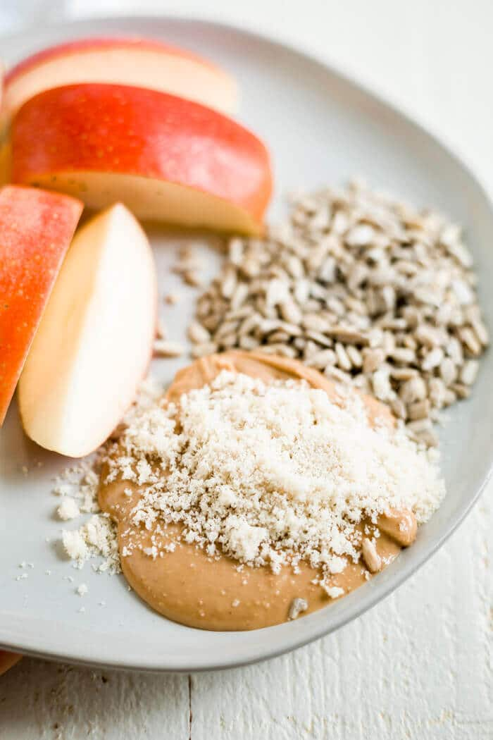 apple with cashew butter, ground sesame seeds and sunflower seeds to eat for seed cycling recipe
