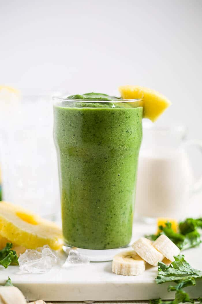 kale smoothie in a glass with pineapple