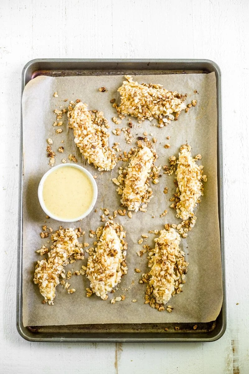rice crispy chicken recipe on a sheet pan with honey mustard