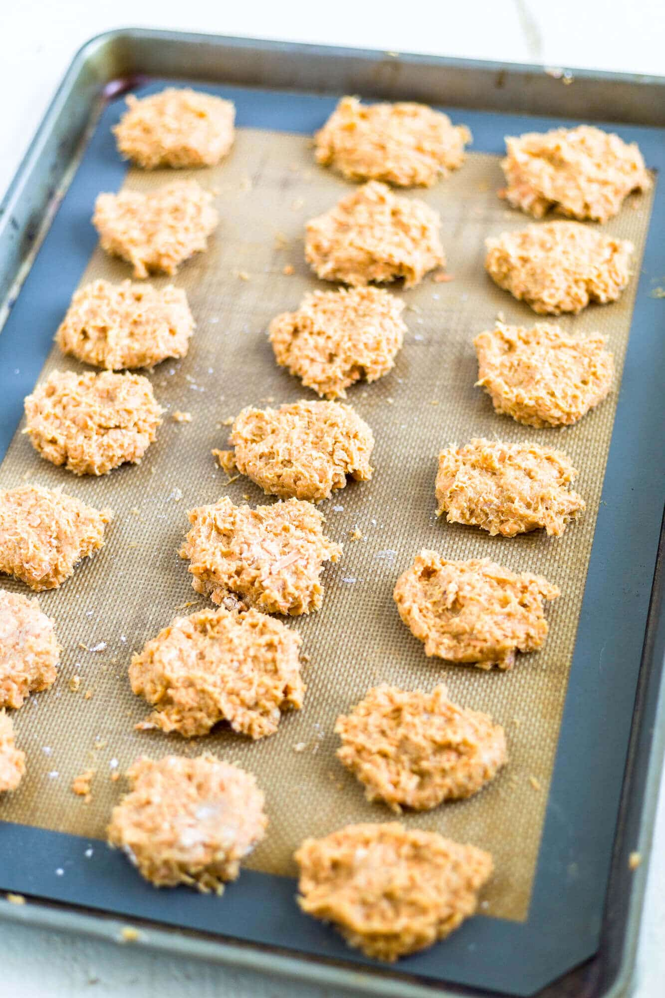 homeamade healthy chicken nuggets on a sheet pan ready to be baked