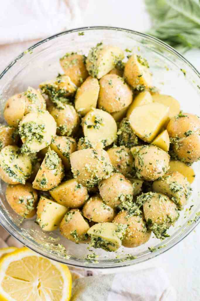 baby potatoes in a glass bowl with pesto