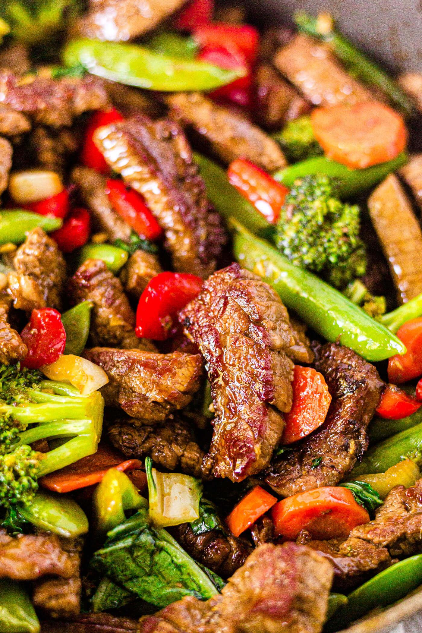steak stir fry in a pan with veggies and teriyaki sauce
