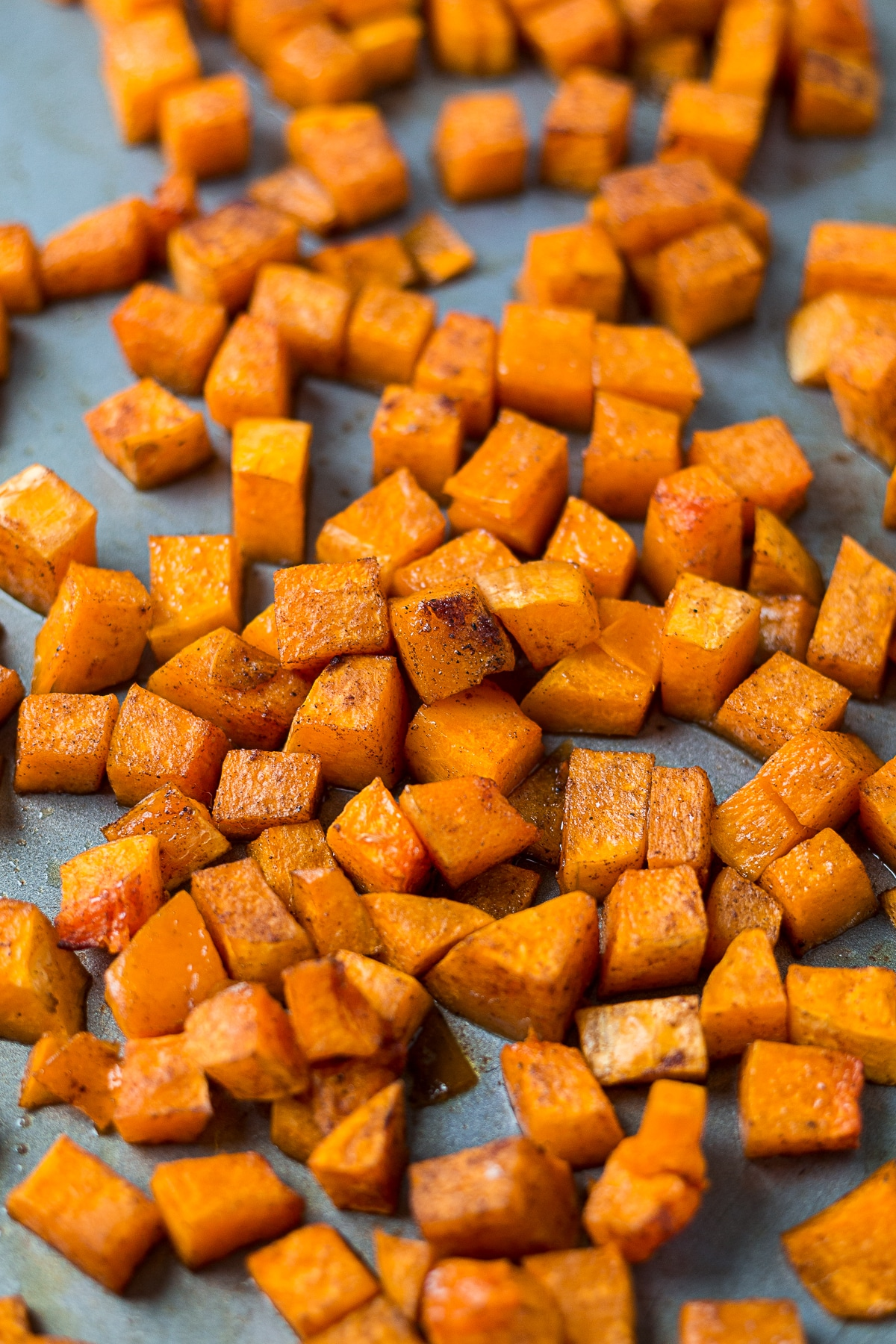 maple cinnamon roasted butternut squash on a sheet pan