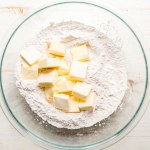 cold butter cubed in a bowl with gluten free flour