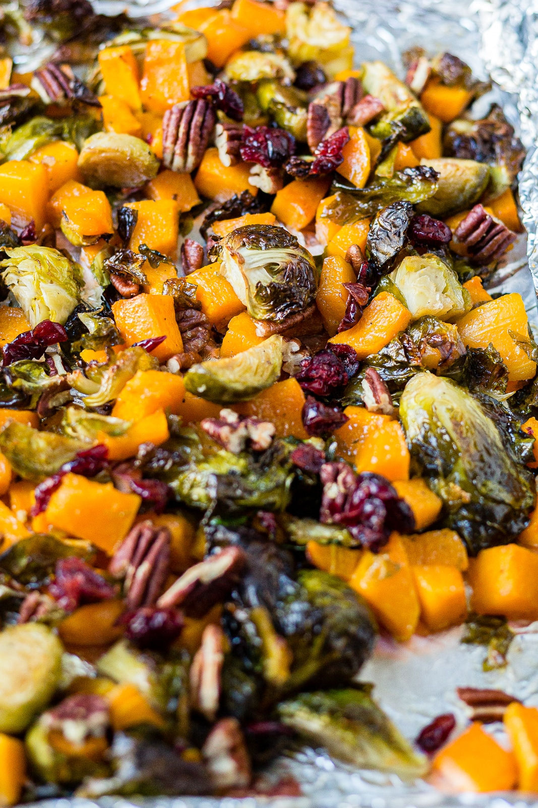 brussels sprouts and butternut squash roasted on a sheet pan