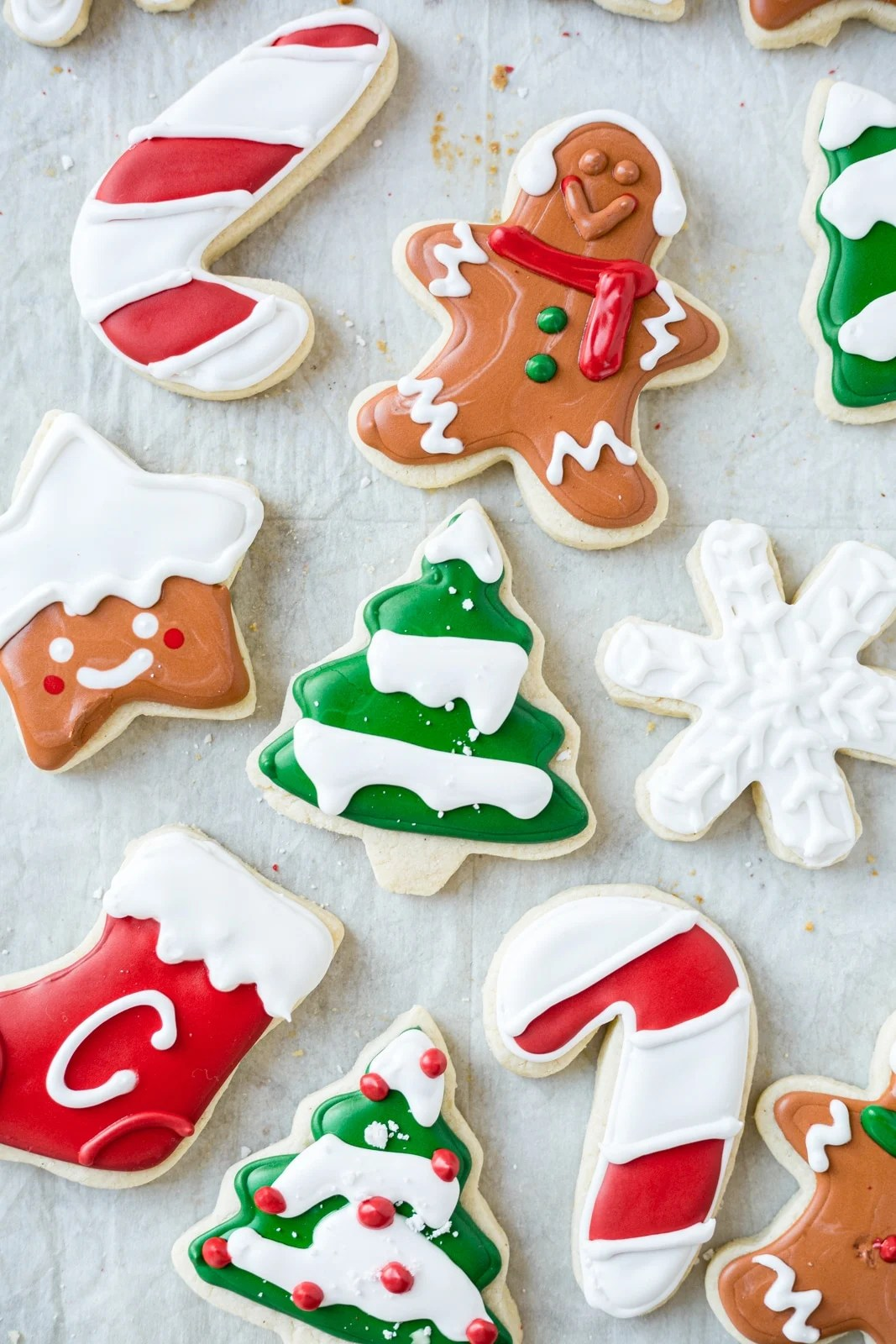 gluten free sugar cookies iced in the shape of trees, gingerbread men and stars with royal icing