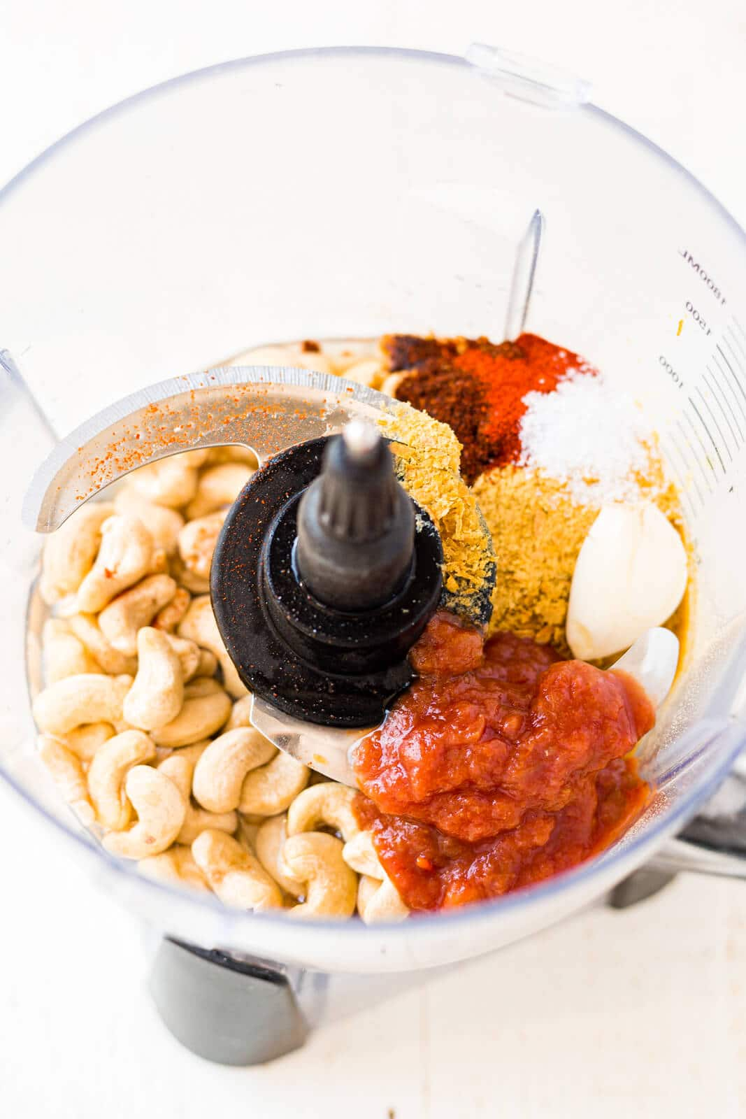 ingredients for cashew queso in the food processor before blending