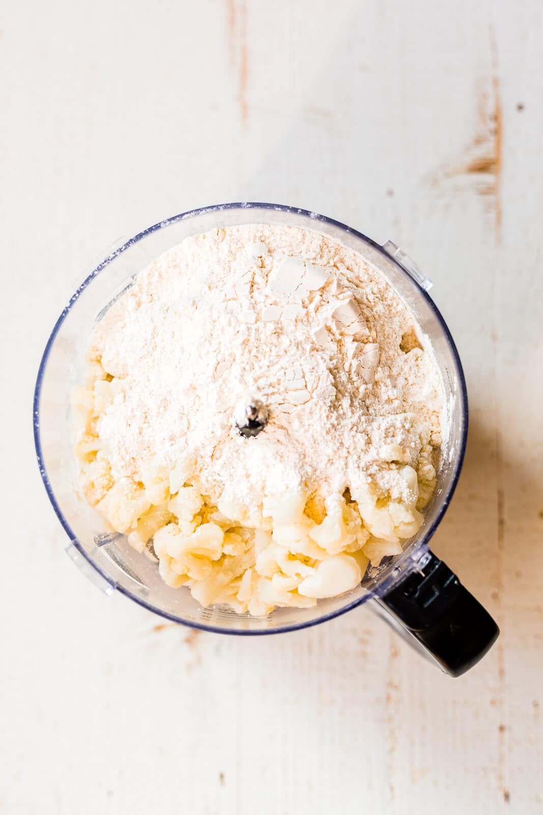 cauliflower and cassava flour in the bowl of a food processor