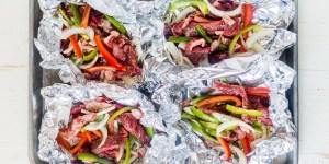 philly cheesesteak foil packs divided into 4 before grilling