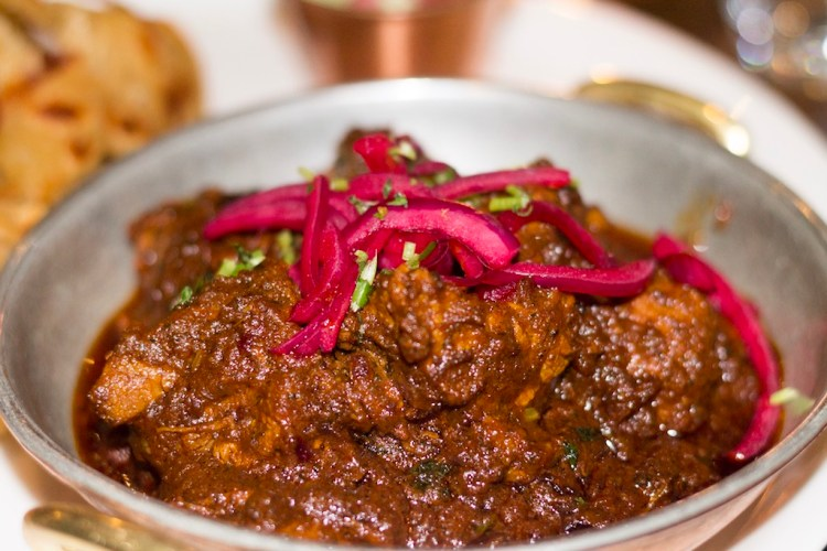 Bhopali style ghee roast - Lamb slowly cooked with dry spices & turmeric with tawa parantha