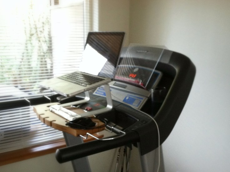 laptop on a laptop holder on top of a treadmill