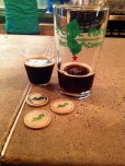 A sampling to the left is the Sweet Stout, while to the right in the glass is the Honey Porter.
