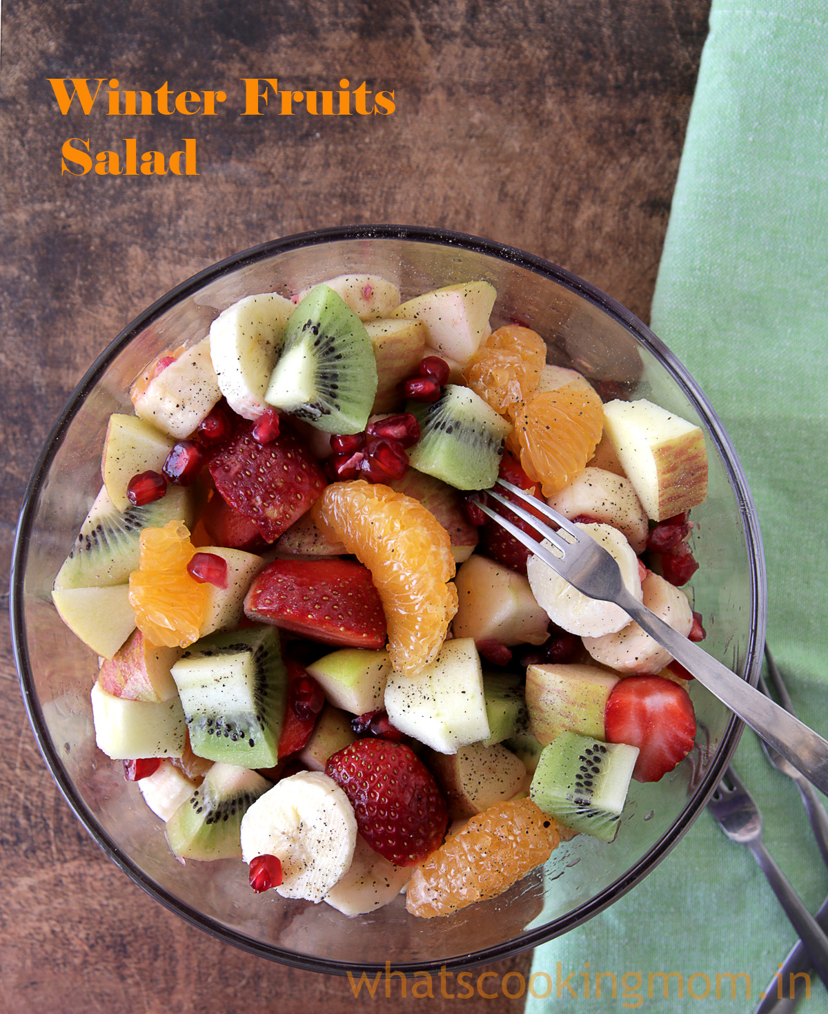 Winter Fruits Salad served in a glass bowl with fork