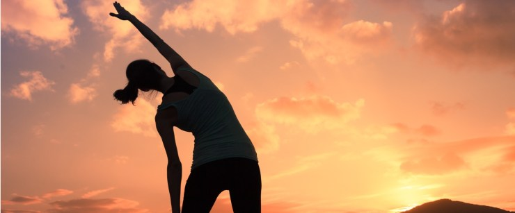 woman stretching sunrise