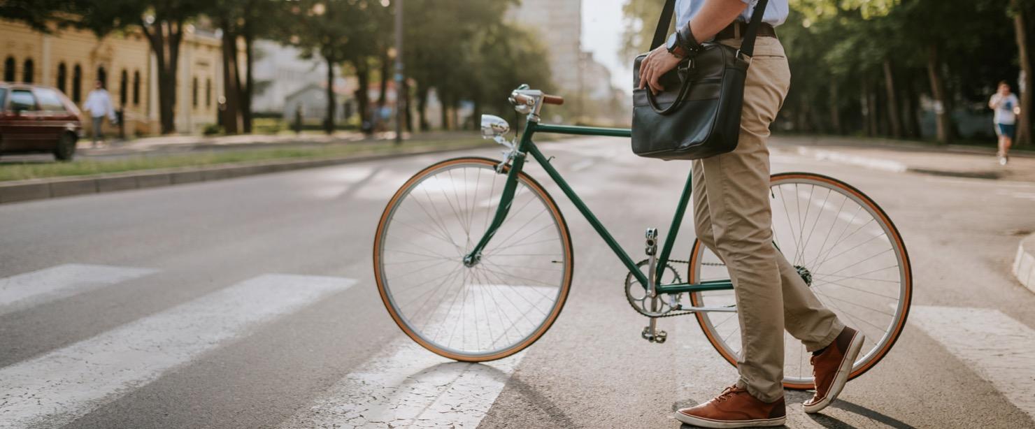 man walking bike to work