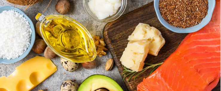 foods high in healthy fats on stone background