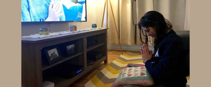 Perri following yoga video at nighttime