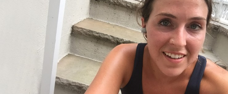 selfie of young woman sweaty and red after workout