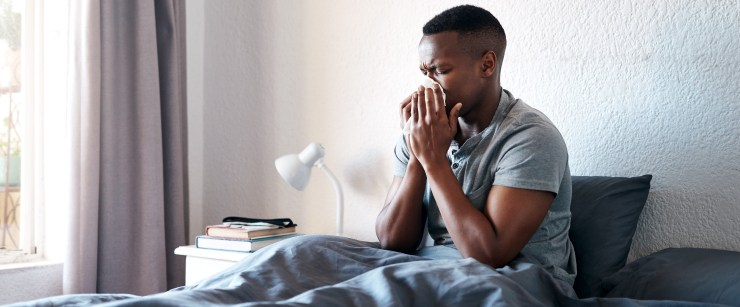 signs you need more zinc: young black man sick in bed