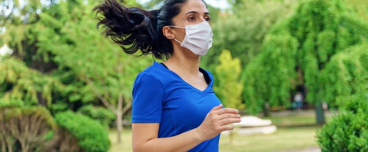 woman running outside in mask