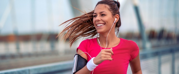 physical activity COVID study: Positive beautiful female runner exercising outdoors on sunny summer morning.