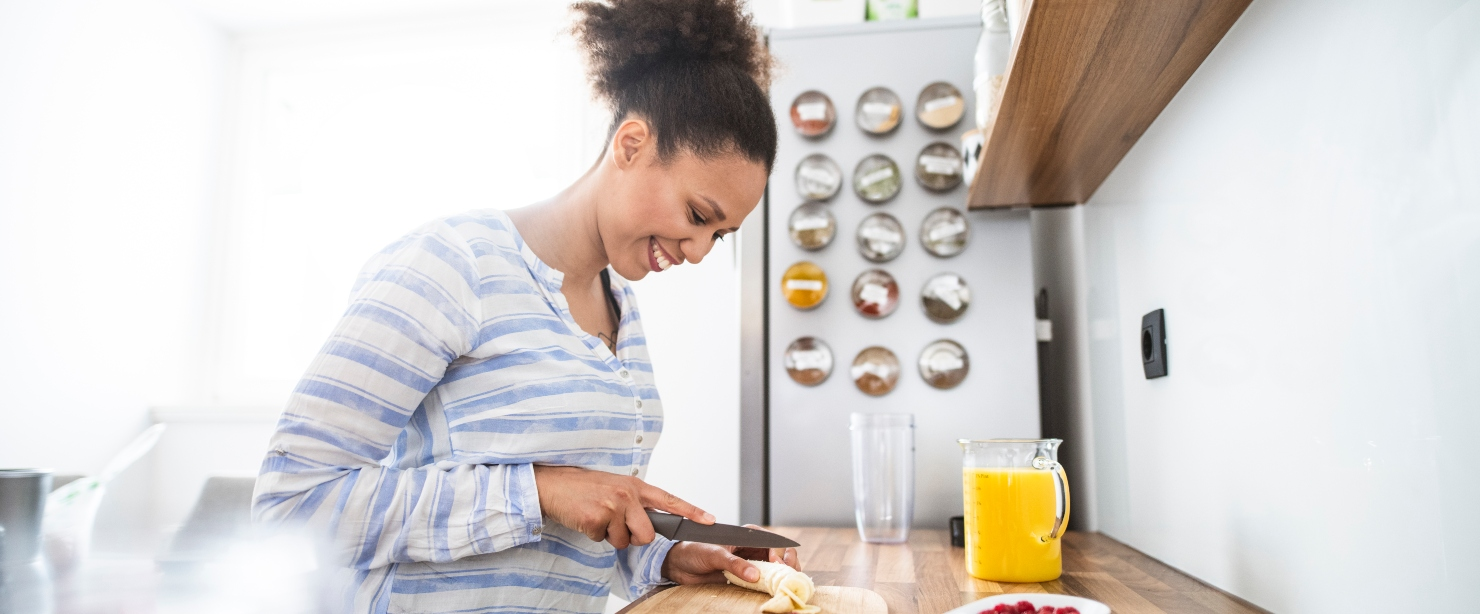 young woman making breakfast