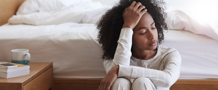 young woman experiencing Sunday scaries before bed
