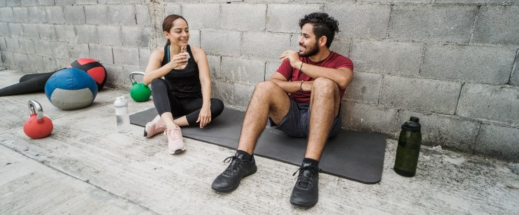 nutrients active people need more of: couple eating after working out together