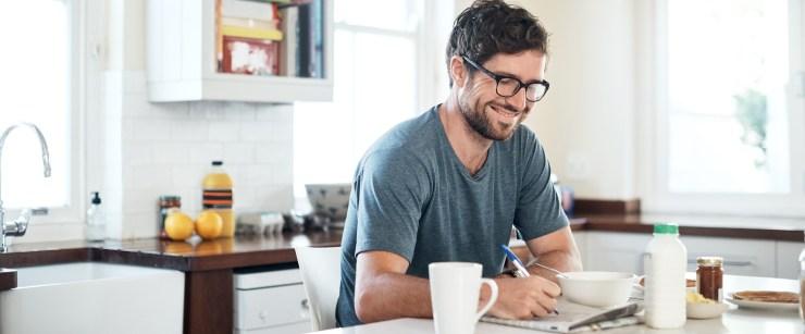 boost your brainpower: man doing crossword at breakfast