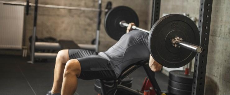 not lifting heavy enough: man bench pressing barbell