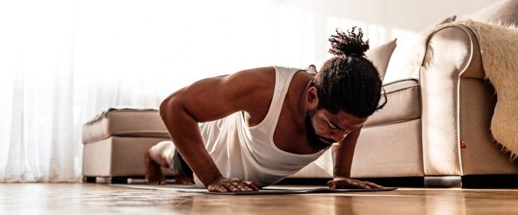 man doing pushups in living room