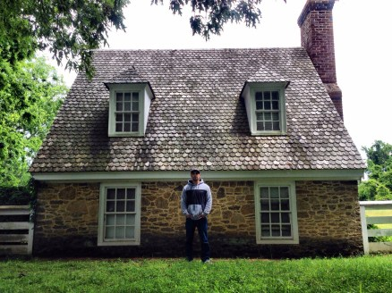 Josh in front of one of the grounds structures of the Moore House