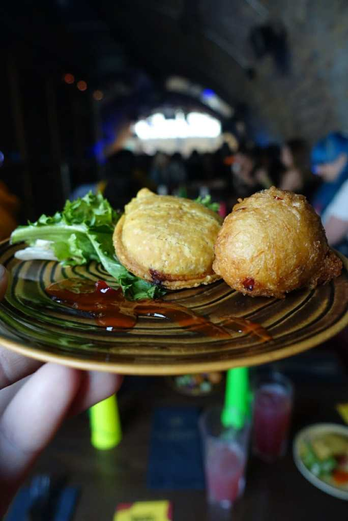 Close up of starter of veggie pasty and salt fish fritter