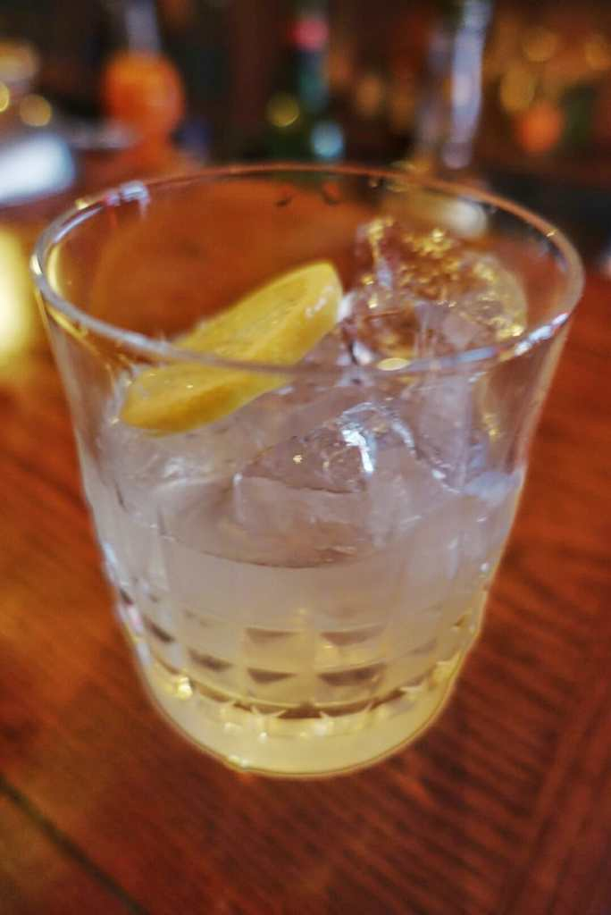 Glass of Limer's punch with ice and lemon slice