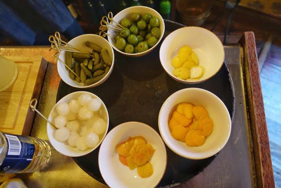 Bowls of the citrus and savoury martini garnishes