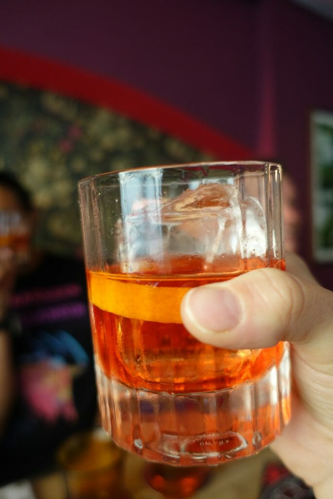 Negroni glass held up in my hand