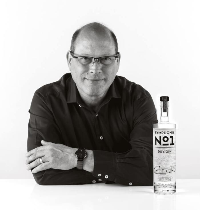 Distiller Ric with a bottle of his Symphonia No. 1 gin