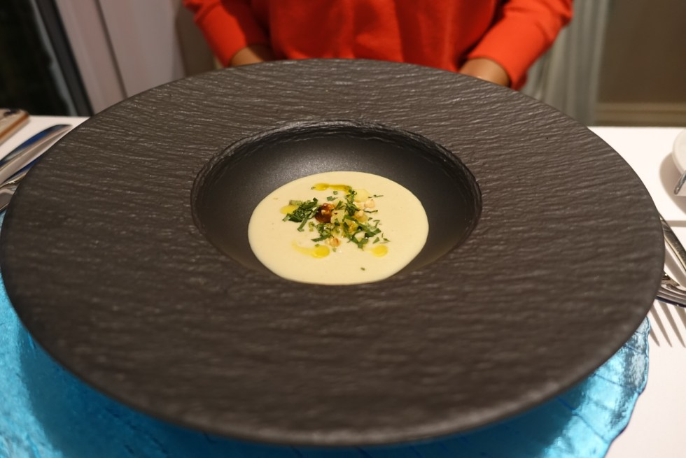 Black bowl with soup