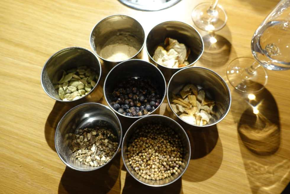 The seven botanicals in Plymouth gin and a tasting glass