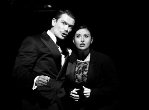 Hayley Tamaddon as Foxy Roxie Hart, pictured here with John Partridge's smooth Billy Flynn.