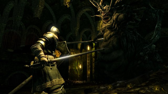A Knight Attacking A Monster in Dark Souls
