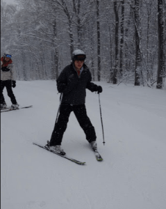 This is a photo taken during a Vermont Adaptive ski lesson at the Middlebury College Snow Bowl
